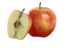 Fresh whole apple and one cut in half. Isolated on a white background Royalty Free Stock Image