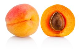 Fresh whole apricot fruit and half isolated on white background. Fresh whole apricot fruit and half isolated on a white background royalty free stock photo