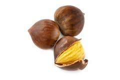 Fresh whole autumn chestnuts Royalty Free Stock Photos