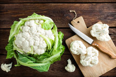 Fresh whole cauliflower on wooden rustic background. Top view Royalty Free Stock Photography