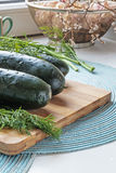 Fresh whole cucumbers and dill portrait side crop Stock Photography