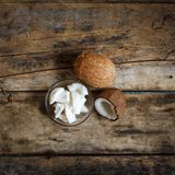 Fresh whole and cut in half coconuts with shreds Royalty Free Stock Photography