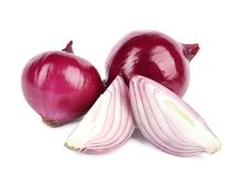 Fresh whole and cut red onions on white. Background stock images