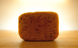 Fresh whole dark bread with halo Royalty Free Stock Photography