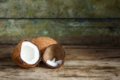 Fresh whole and half coconuts with coconut shreds Stock Photography