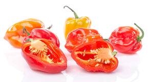 Fresh whole and half habanero peppers Stock Image