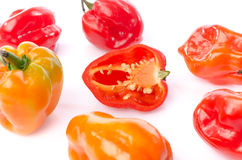 Fresh whole and half habanero peppers Stock Images