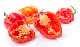 Fresh whole and half habanero peppers Stock Photography