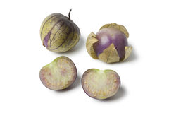 Fresh whole and half tomatillos Stock Images