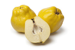 Fresh whole and half yellow Quinces. On white background Stock Photos