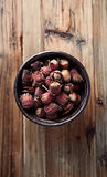Fresh whole hazelnuts in a ceramic bowl Royalty Free Stock Photos