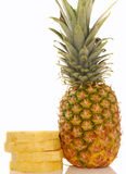 Fresh whole pineapple with cut slices Royalty Free Stock Photography