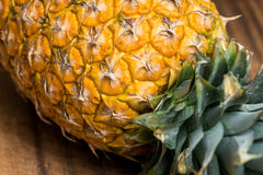 Fresh whole Pineapple. On wooden board Royalty Free Stock Image