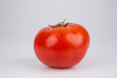 Fresh whole ripe tomato Stock Image