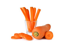 Fresh whole and sliced carrots on white Royalty Free Stock Photography