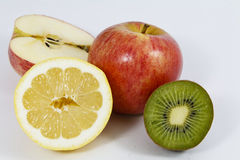 Fresh whole and sliced fruit Stock Photography