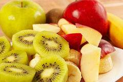Fresh whole and sliced fruit closeup Stock Images