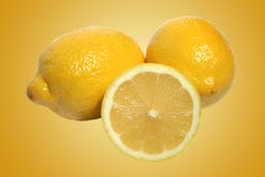Fresh whole and sliced lemons Royalty Free Stock Photo