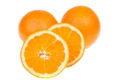 Fresh whole and sliced orange fruits, isolated on white Stock Photos