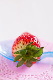 Fresh whole strawberry and spoon Stock Image
