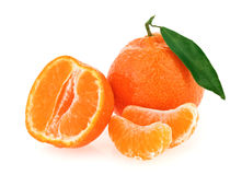 Fresh whole tangerine with some slices. And green leaf isolated on white Royalty Free Stock Image