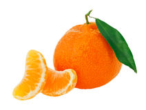 Fresh whole tangerine with some slices. And green leaf isolated on white Royalty Free Stock Photos