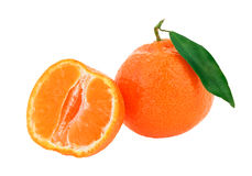 Fresh whole tangerine with some slices. And green leaf isolated on white Stock Photo