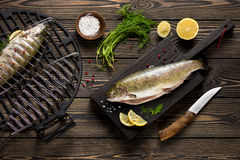 Fresh whole trout fishes prepared to grill. Top view Royalty Free Stock Photos