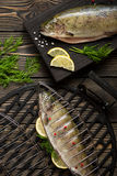 Fresh whole trout fishes prepared to grill. Top view Stock Photo