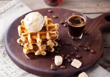 Fresh whole wheat waffles, ice cream, maple syrup Royalty Free Stock Photography