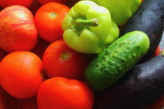 Fresh wholesome vegetables. Preparation of tomatoes, cucumbers, peppers to make a salad Royalty Free Stock Photo