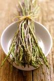 Fresh wild asparagus. On plate Stock Photo