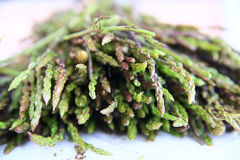 Fresh wild asparagus for background. Detailed shot of fresh raw wild asparagus for background Royalty Free Stock Images