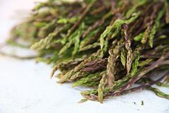Fresh wild asparagus for background. Detailed shot of fresh raw wild asparagus for background Royalty Free Stock Photos