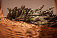 Fresh wild asparagus on a basket ready to be cooked Royalty Free Stock Photography
