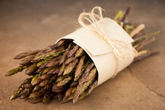 Fresh wild asparagus bought on market ready to be cooked Stock Image