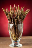 Fresh wild asparagus in a glass ready to be cooked Stock Image