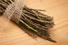 Fresh wild asparagus on a wooden table Stock Photos