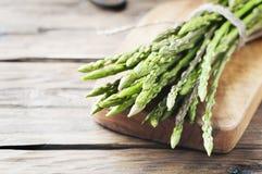 Fresh wild asparagus on the wooden table Royalty Free Stock Photos