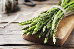 Fresh wild asparagus on the wooden table Royalty Free Stock Photography