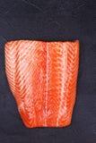 Fresh Wild Salmon. On Grey Stone Background. View from above, top studio shot Stock Photo