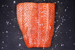 Fresh Wild Salmon. On Grey Stone Background. View from above, top studio shot Stock Photography