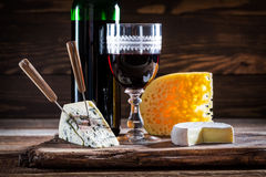 Fresh wine in glass with cheese and grapes Royalty Free Stock Photography