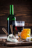 Fresh wine in glass with grapes and cheese Royalty Free Stock Images