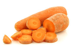 Fresh winter carrot and a cut one Royalty Free Stock Images