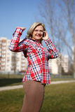 Fresh woman calling outdoor at spring Stock Photography