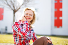Fresh woman in flannel shirt calling outdoor Royalty Free Stock Photo