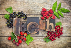 Fresh, word with assorted berry fruits Royalty Free Stock Images