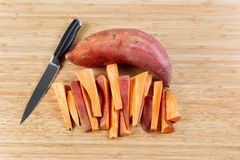 Fresh Yams sliced on Bamboo cutting board Royalty Free Stock Photos