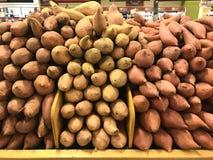 Fresh yams and sweet potatoes at supermarket Royalty Free Stock Images